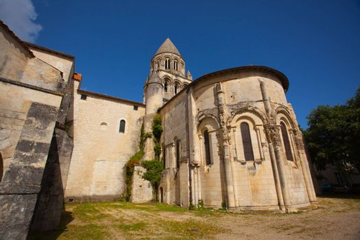 General view with abse and tower of the romanesque chruch of Abbaye aux Dames in Saintes France