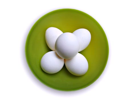 Isolated top view of eggs in a bowl