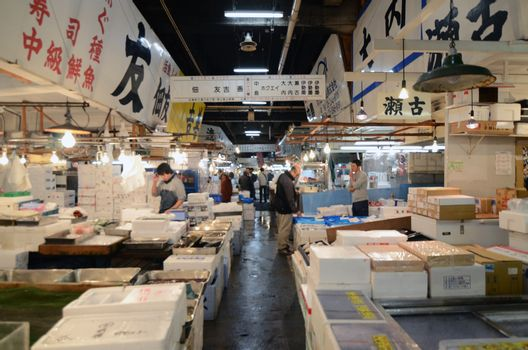 TOKYO - NOV 26: Seafood vendors at the Tsukiji Wholesale Seafood