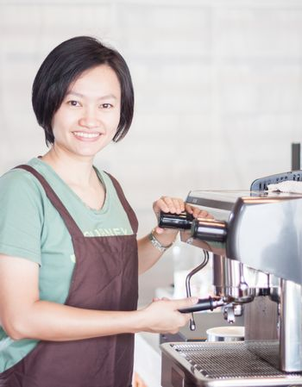 Woman barista enjoy at work, stock photo