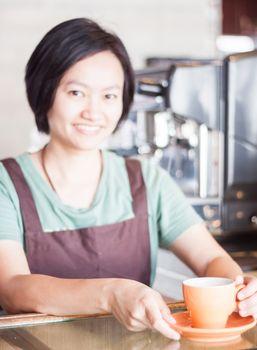 Barista prepares freshly brewed coffee, stock photo