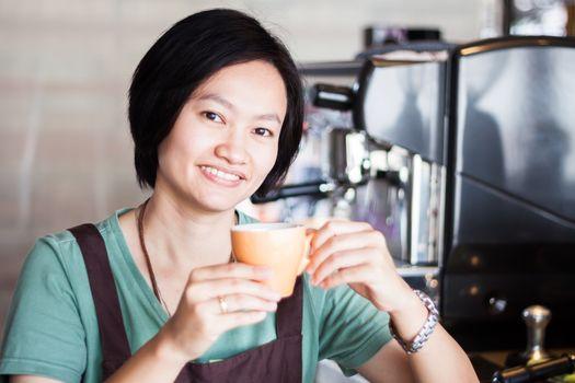 Asian barista enjoy her coffee, stock photo
