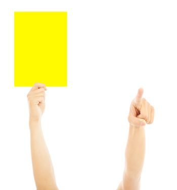 Hand of referee with big yellow card to warn