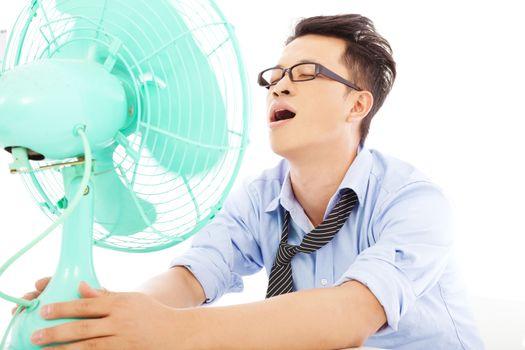 business man  suffering a hot  summer heat with fans