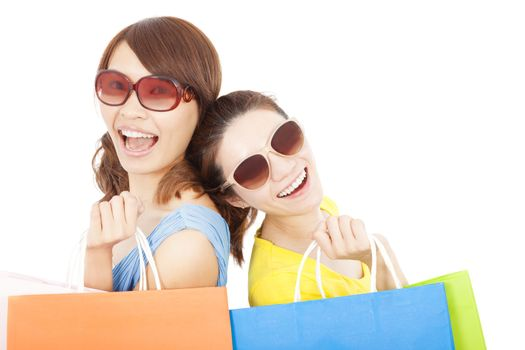 young sisters holding shopping bags and Back to back