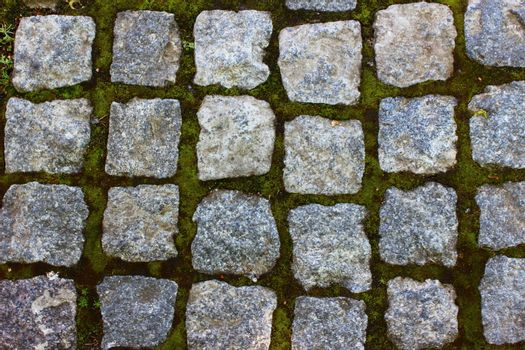 gray-brown stone pavers are laid in neat rows