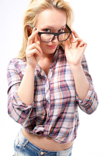 Fashionable, sensual blonde girl in stylish glasses dressed in shirts and shorts