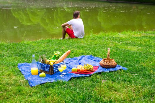 Young man on picnic alone