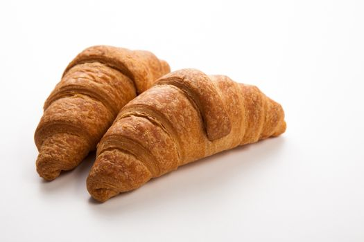 two croissants on grey