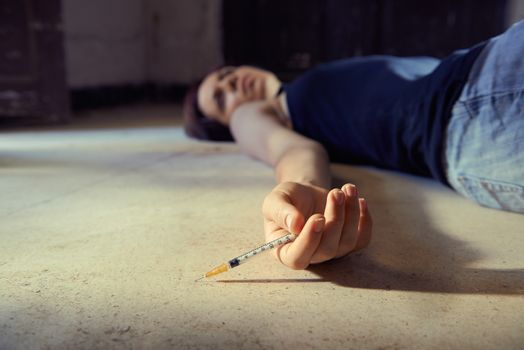Drug abuse-young woman injecting heroine with syringe