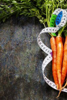 fresh carrots measurement tape