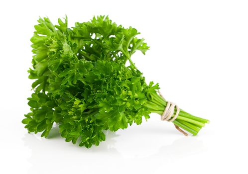 parsley tied with an cord band in white background.