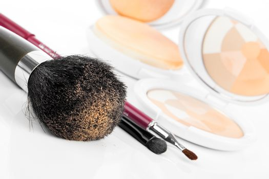 compact powder and black brush isolated