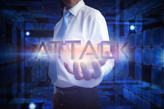 Businessman presenting the word attack
