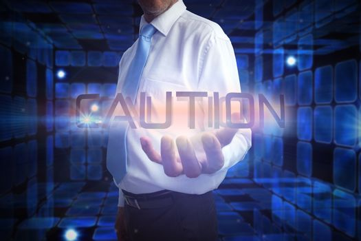 Businessman presenting the word caution