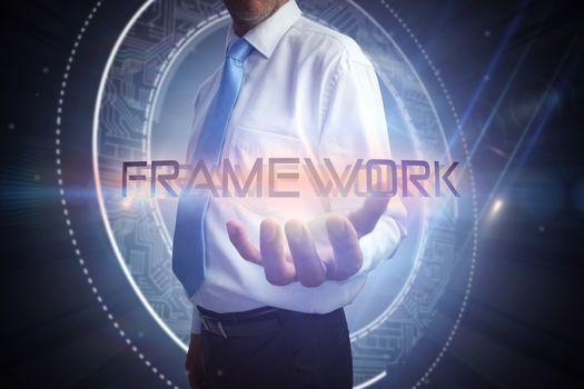 Businessman presenting the word framework