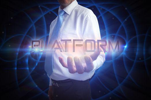 Businessman presenting the word platform