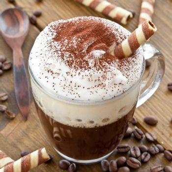 Cup of coffee with creamy milk foam