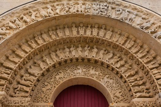 Archivolts detail of Aulnay de Saintonge church in Charente Maritime region of France