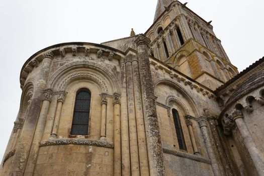 Close-up abse and tower view of Aulnay de Saintonge church in Charente Maritime region of France