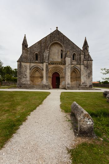 Full main entrance view of Aulnay de Saintonge church in Charente Maritime region of France