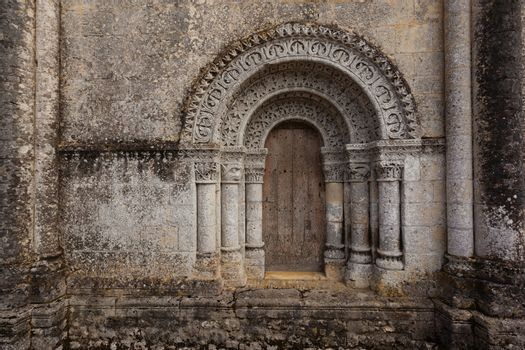 Horizontal pic from North door of Notre-Dame de l'Assomption de Fenioux church in Charente Maritime region of France