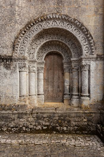 North door of Notre-Dame de l'Assomption de Fenioux church in Charente Maritime region of France