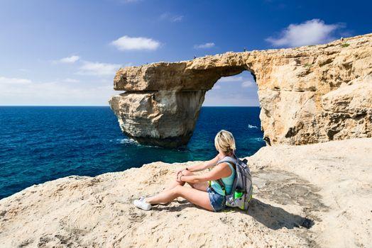 Girl looking on Azure Window on Gozo Island