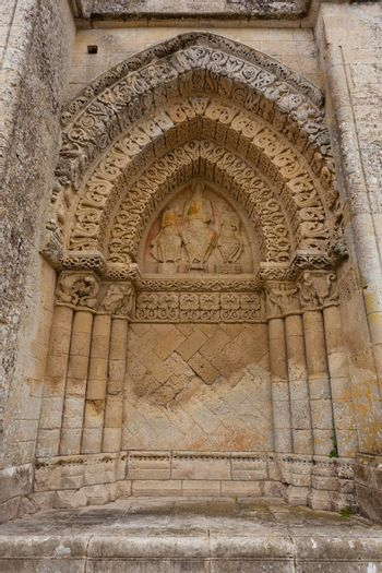 Right side facade  of Aulnay de Saintonge church in Charente Maritime region of France