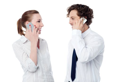 Business executives engaged over a phone call