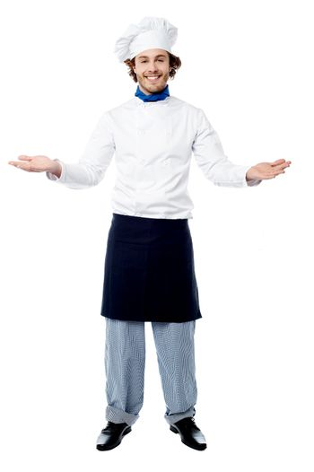 Male chef in uniform welcoming guests
