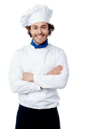 Confident young chef posing in uniform