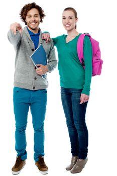 Girl resting her arm on classmates shoulder