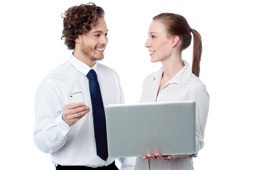 Business executives working on laptop