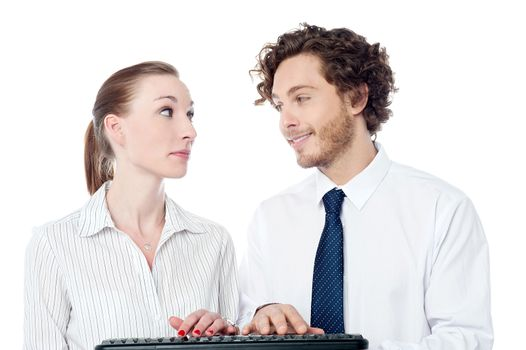 Young secretaries typing in keyboard