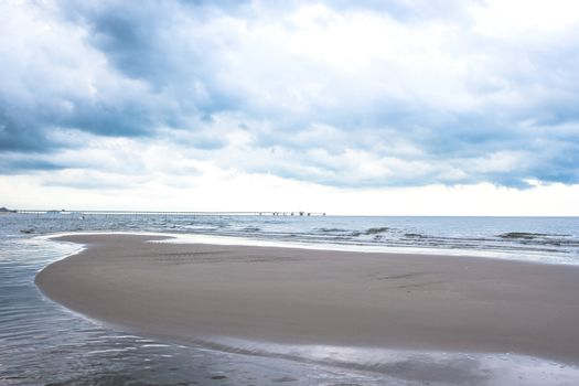 Stormy sky over dark sand and sea