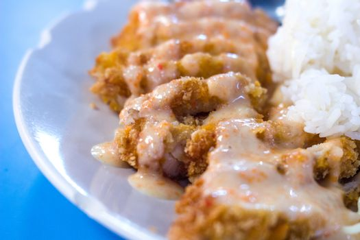 fried chicken with lemon cream sauce and rice