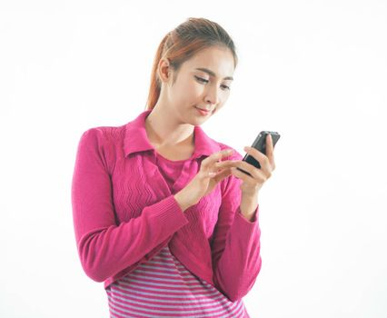 Beautiful smiling young woman holding a smart phone isolated on white background