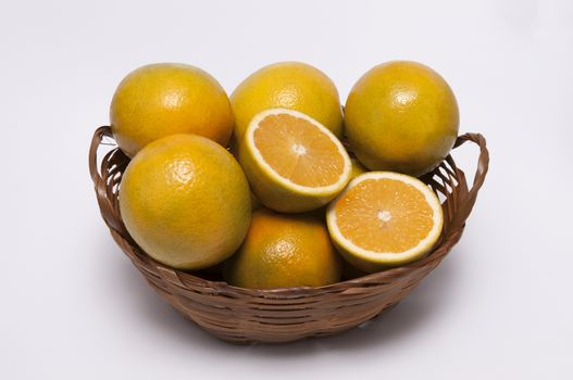 A Wicker Basket With Oranges