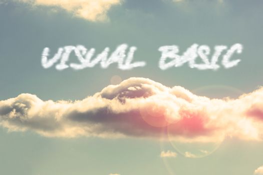 Visual basic against bright blue sky with cloud