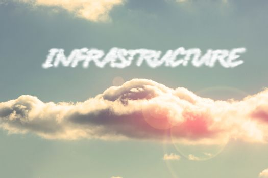 Infrastructure against bright blue sky with cloud