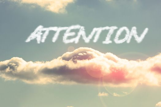 Attention against bright blue sky with cloud