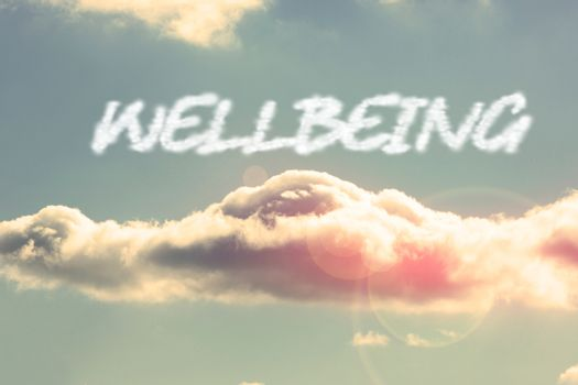 Wellbeing against bright blue sky with cloud