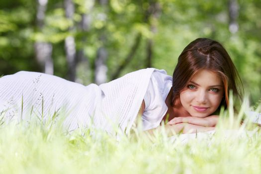 Woman wake up on grass