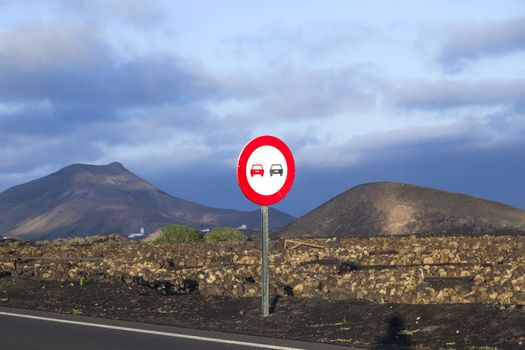 Landscape with a traffic sign: Don't overtake