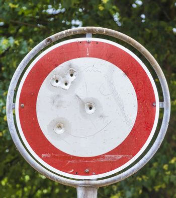 No vehicles traffic sign with bullet hole