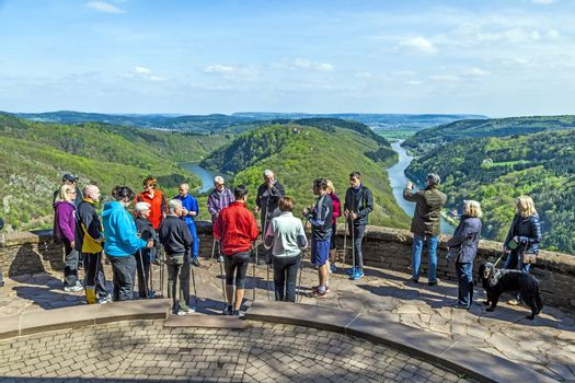 CLOEF, GERMANY - APRIL 29, 2013: people enjoy the spectacular view  to Saar loop at Cloef, Germany. The scenic spot was built in 1856 and is the most famous saar view spot in the Saarland.
