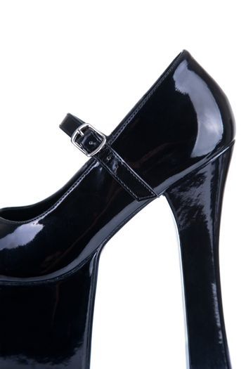 Close-up shot of a black fetish shoe, isolated on white background