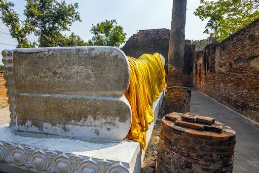 lying Buddha dressed in yellow scarf in temple Wat Yai Chai-mongkol