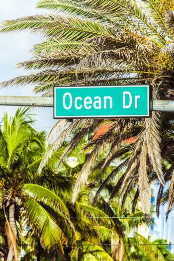 street sign at Ocean drive in Miami Beach, Florida. Art Deco architecture in South Beach is one of the main tourist attractions in Miami.